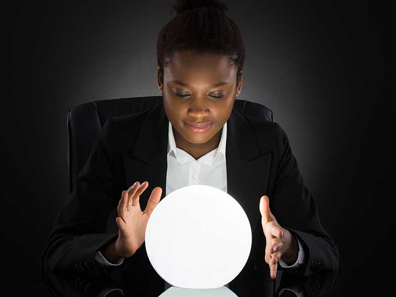 a person looking into a crystal ball